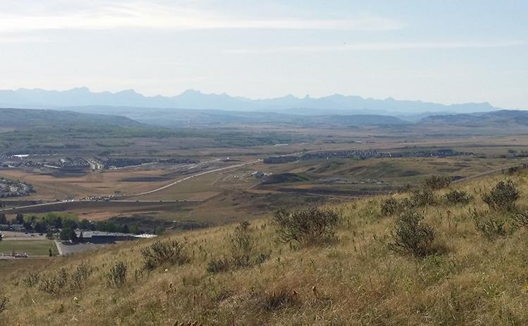 View overlooking Cochrane Alberta towards the Rocky Mountains.